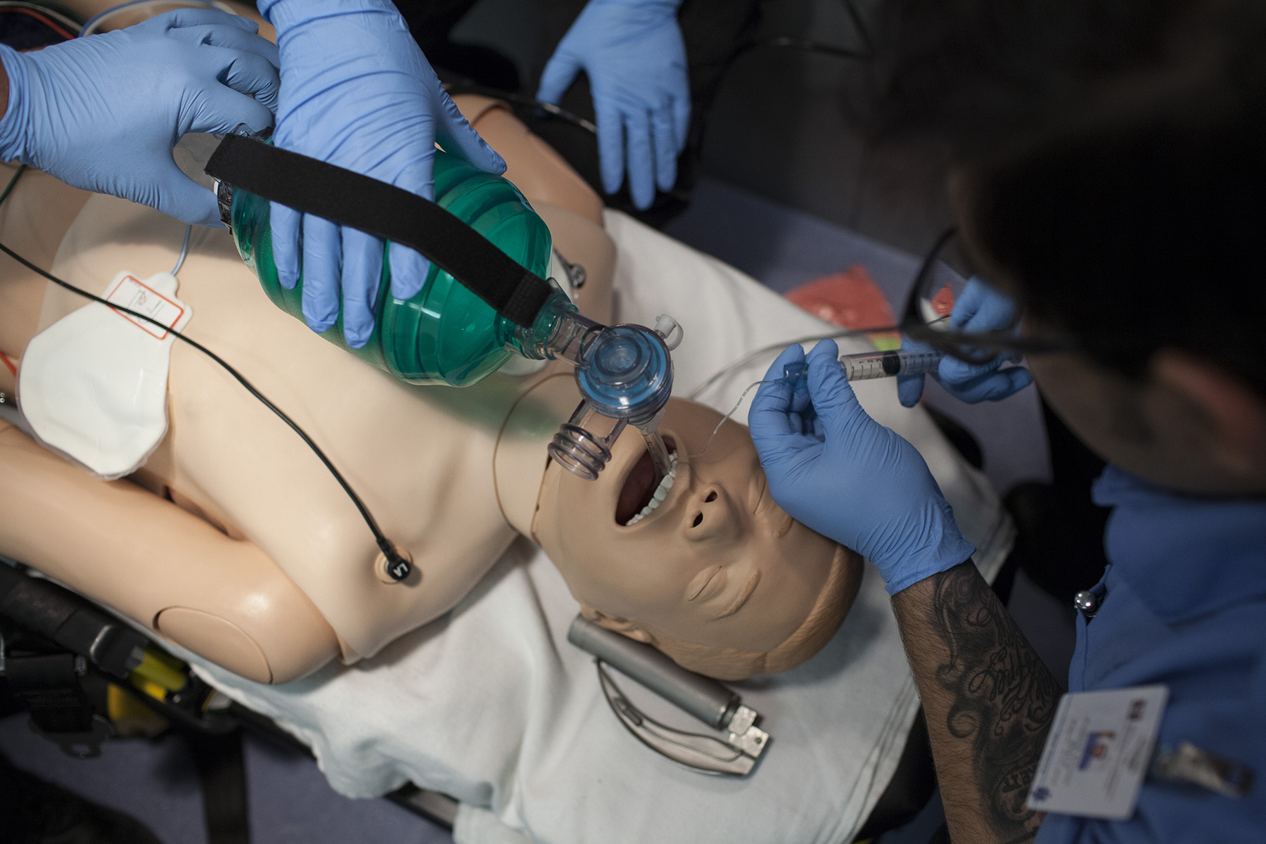 Wharton County Junior College Emergency Medical Services Program students practice lifesaving skills on a mannequin in the back of a mock ambulance. The program will begin offering classes in Bay City in January of 2018.
